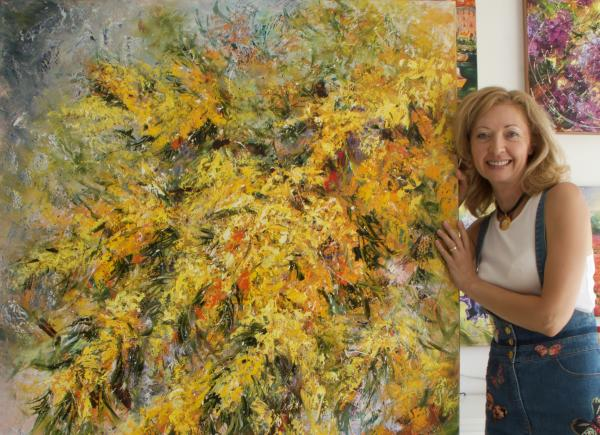 Diana Malivani with one of her favourite artworks, «Mimosa», in her Artist's Studio in Limassol, Cyprus
